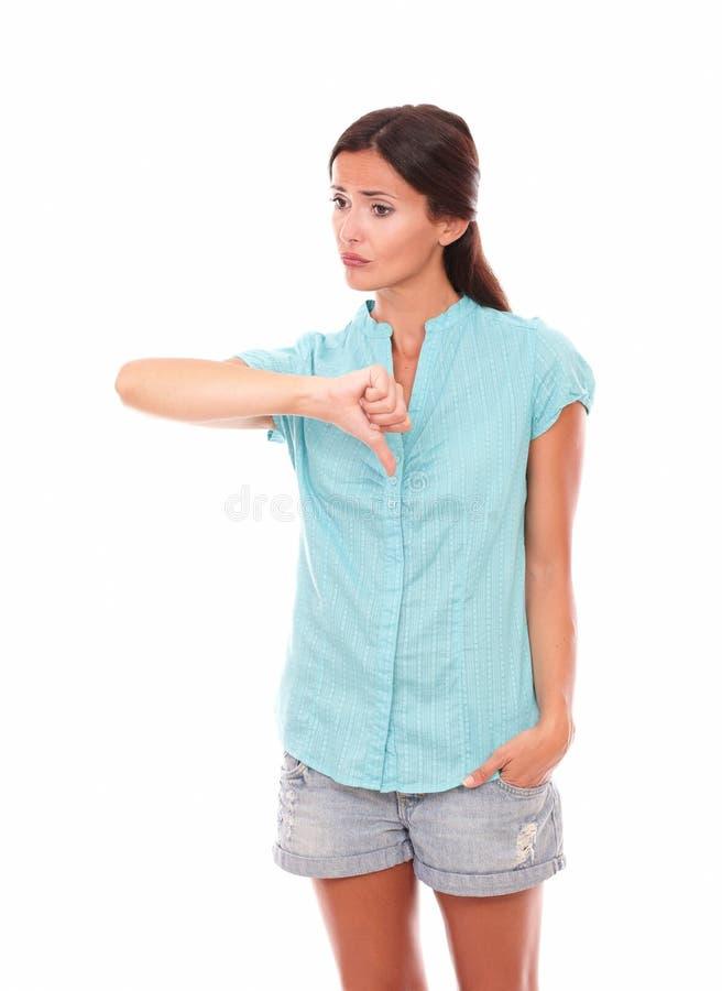 Nieszczęśliwa łacińska dziewczyna z kciuka puszkiem obrazy stock