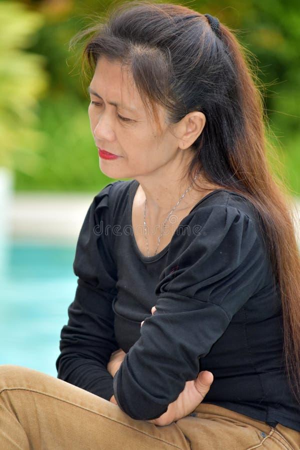 Nieszczęśliwy filipinka kobiety senior zdjęcie stock