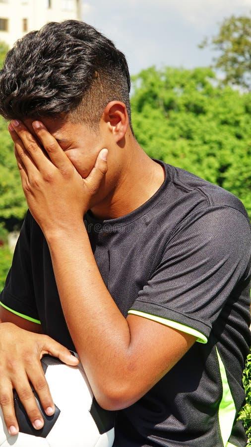 Nieszczęśliwy Latynoski Męski gracz piłki nożnej obraz stock