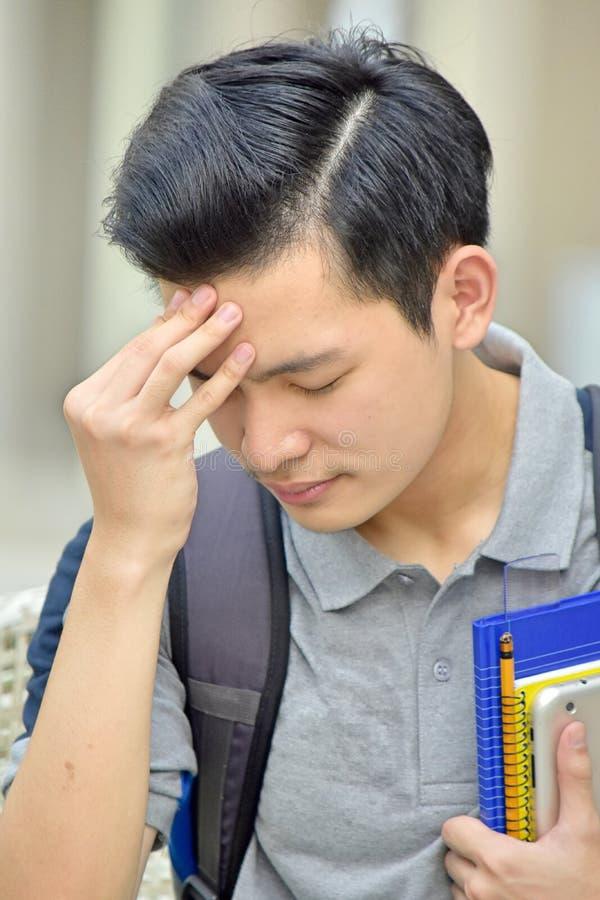 Nieszczęśliwy Męski uczeń Z książkami obraz stock