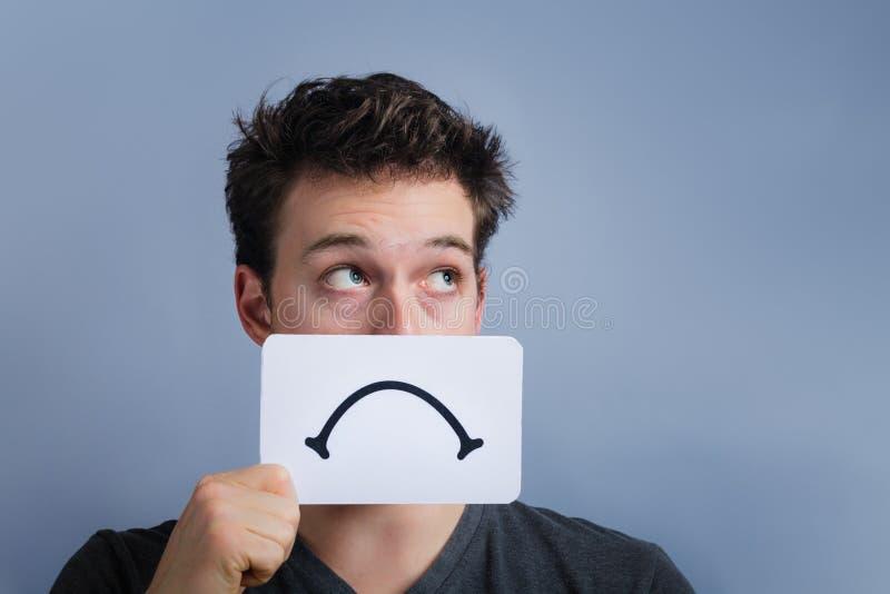 Nieszczęśliwy portret someone Trzyma Smutną nastrój deskę zdjęcia stock
