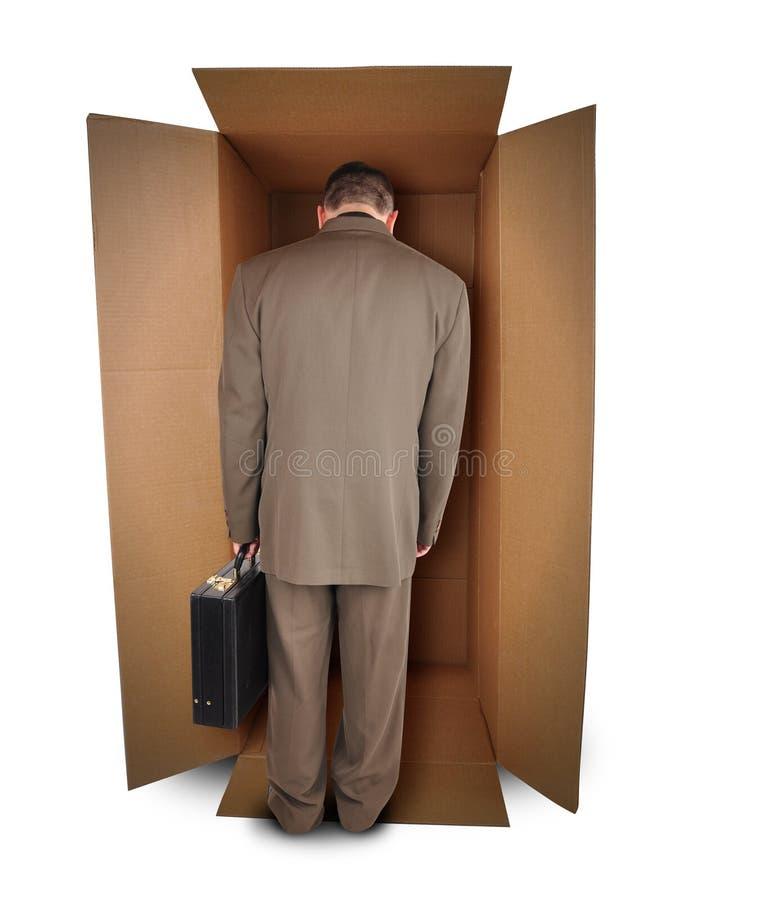 nieszczęśliwy pudełkowaty biznesowy akcydensowy mężczyzna zdjęcie stock