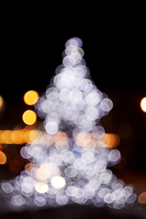 Nieuw jaar De kerstboom Verstralers Donkere achtergrond royalty-vrije stock afbeelding