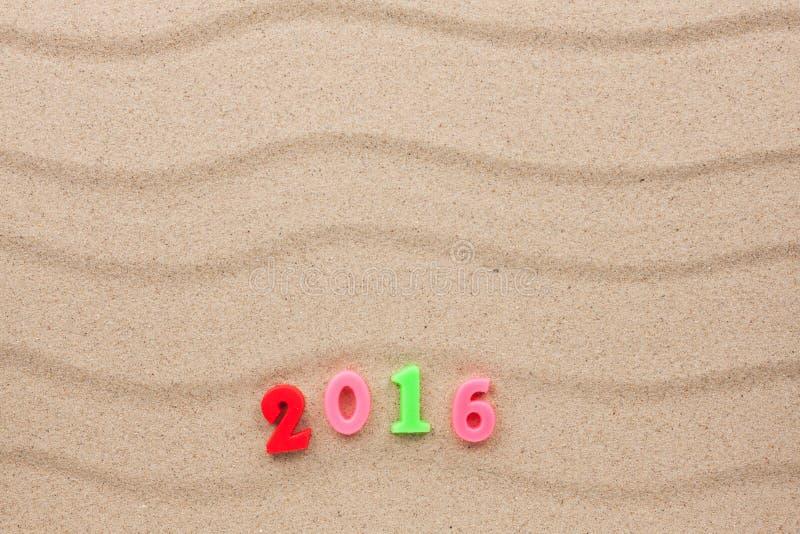 Nieuw jaar 2016 geschreven in San stock fotografie