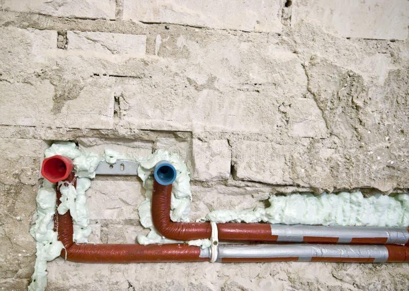 Nieuw loodgieterswerk in een muur royalty-vrije stock afbeelding