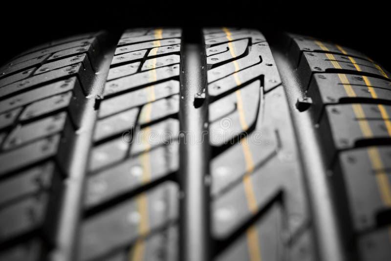 Nieuwe auto het dichte patroon van rubber, detail stock afbeeldingen