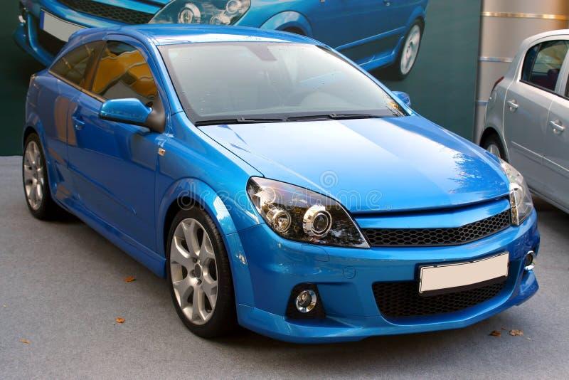 Nieuwe blauwe auto royalty-vrije stock afbeeldingen