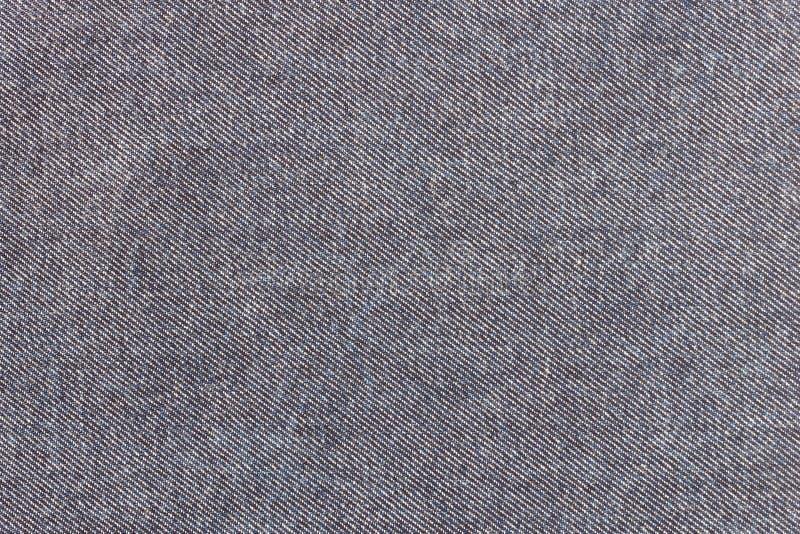Nieuwe Donkerblauwe Jeanstextuur of van de Denimtextuur Achtergrond stock afbeeldingen