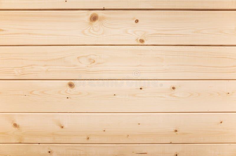 Nieuwe houten die muur van de planken van de pijnboomboom wordt gemaakt royalty-vrije stock afbeeldingen