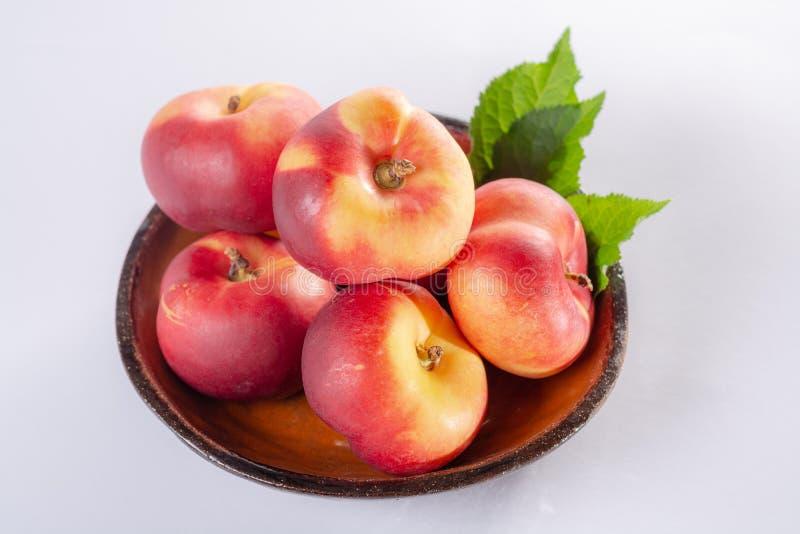 Nieuwe hybride zoete platerina van fruitnectarina, vlakke Saturn of doughnut stock fotografie