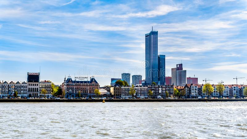 The Nieuwe Maas river with the Modern Sky Scrapers beside historic houses on the shore of Noordereiland in the center of Rotterdam. Rotterdam/the Netherlands stock photo