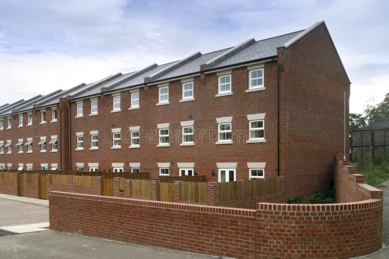 Nieuwe terrasvormige huisvesting royalty-vrije stock afbeelding