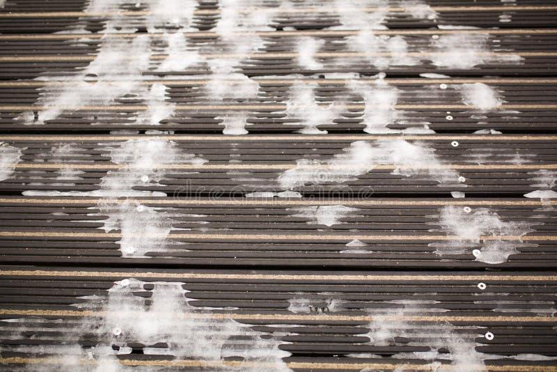 Nieve congelada en la superficie del pavimento imagen de archivo libre de regalías