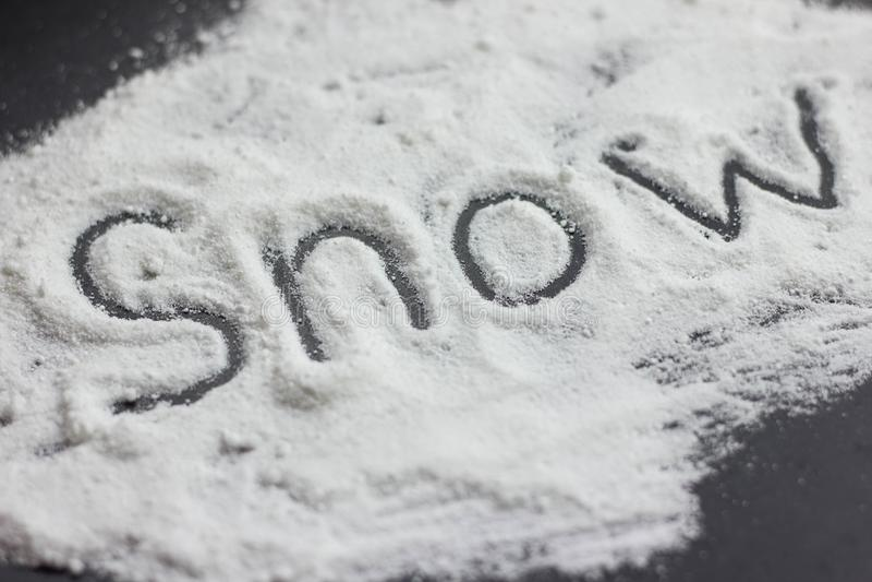 nieve de la inscripción en la cocaína imagenes de archivo