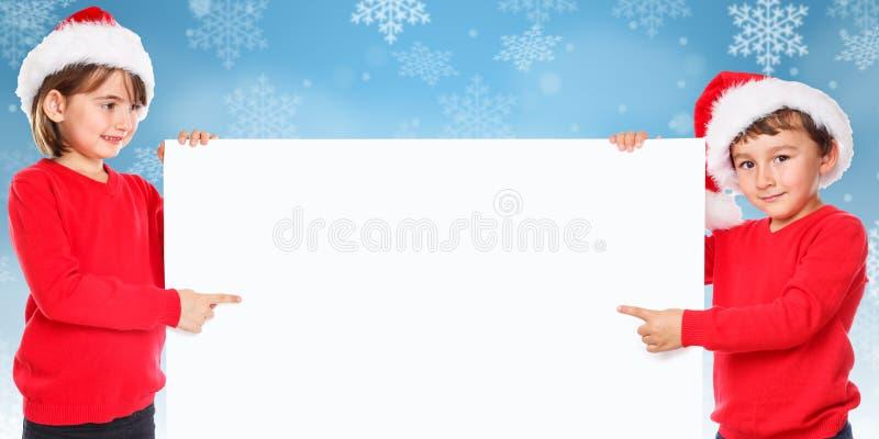 Nieve de los niños de los niños de Santa Claus de la Navidad que señala parecer vacío imagen de archivo