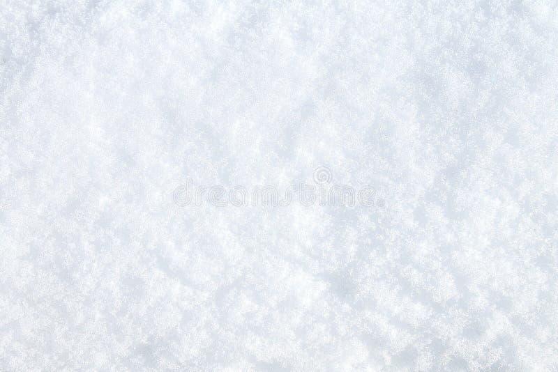 Nieve del invierno Opinión superior de la textura de la nieve de la nieve Textura para el diseño Textura del blanco nevado Copos  fotografía de archivo