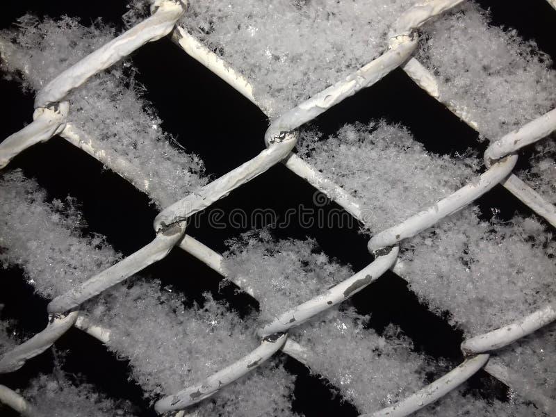 Nieve en la cerca fotografía de archivo