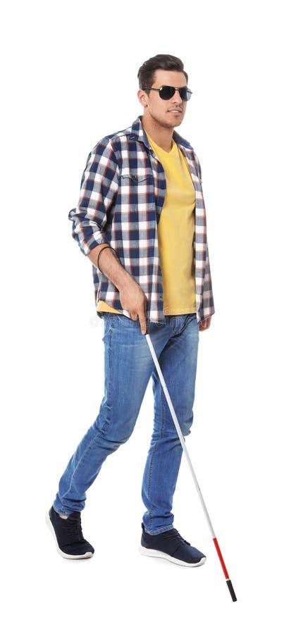 Niewidomy mężczyzna z długą trzciną na bielu zdjęcia royalty free
