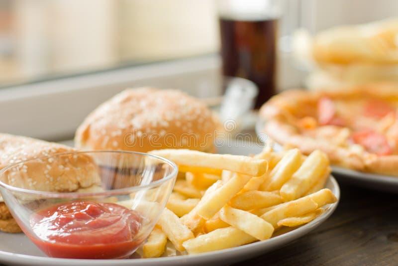 Niezdrowy pojęcie jedzenie niezdrowy obrazy royalty free
