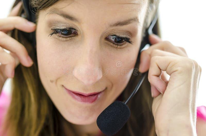 Nieznacznie zaniepokojony centrum telefoniczne pracownik zdjęcia stock