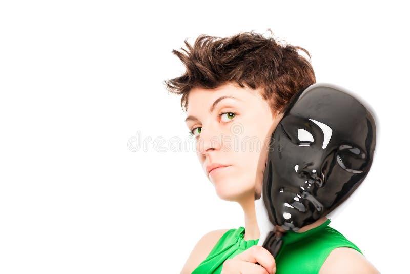 Nieznajomy out od glansowanej czerni maski na bielu za obraz stock