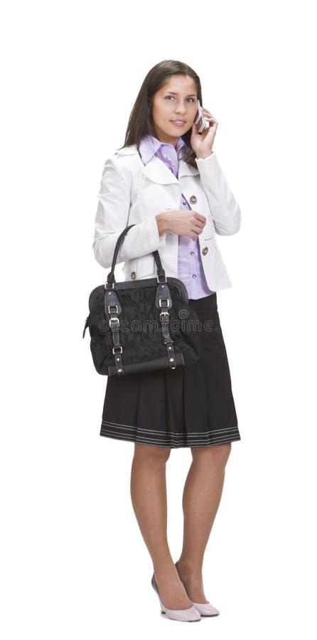 niezobowiązująco ubierająca telefonu obcojęzyczna kobieta zdjęcia royalty free