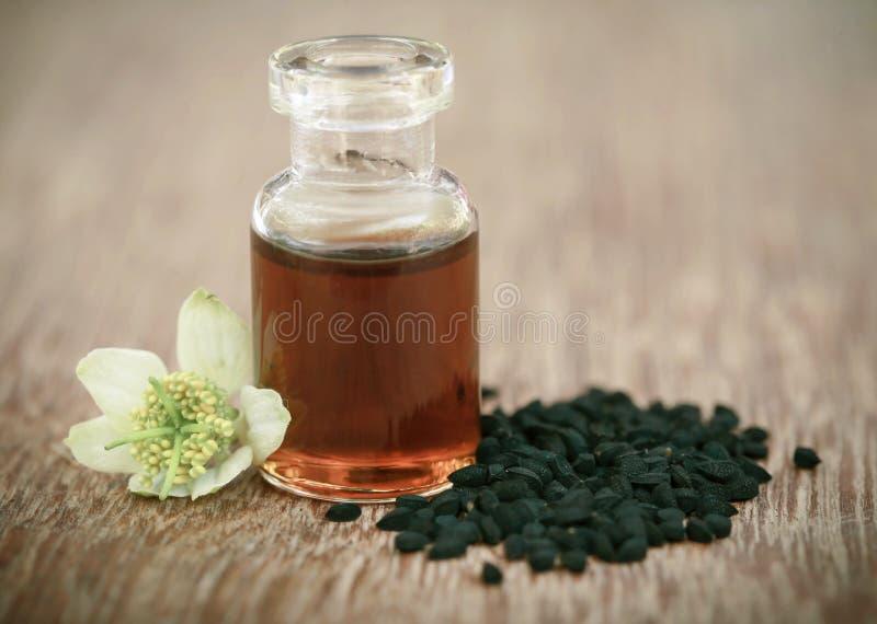 Download Nigella Flower With Seeds And Essential Oil Stock Image - Image of seasonings, caraway: 88506065