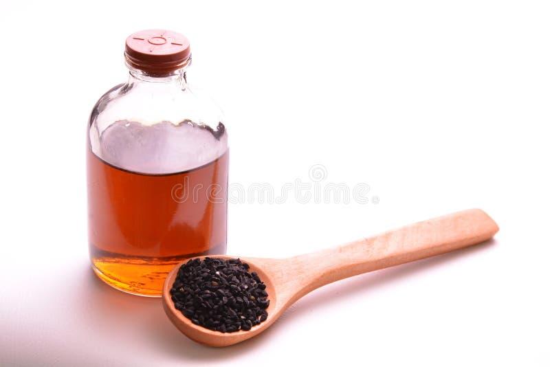 Nigella sativa olie royalty-vrije stock foto