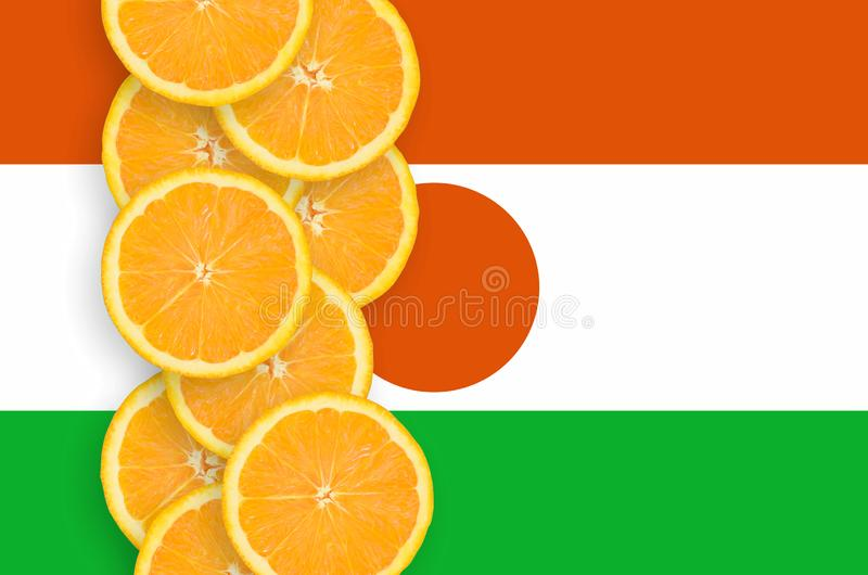 Niger flag and citrus fruit slices vertical row. Niger flag and vertical row of orange citrus fruit slices. Concept of growing as well as import and export of stock images