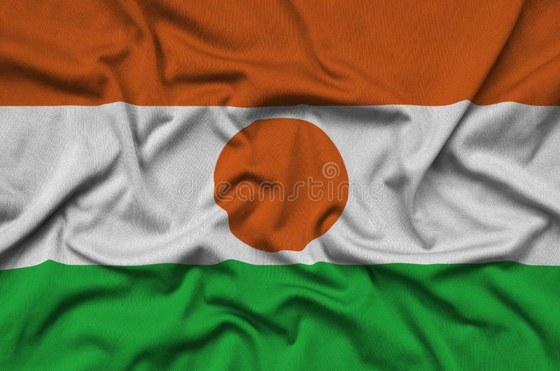 Niger flag is depicted on a sports cloth fabric with many folds. Sport team banner. Niger flag is depicted on a sports cloth fabric with many folds. Sport team royalty free stock image