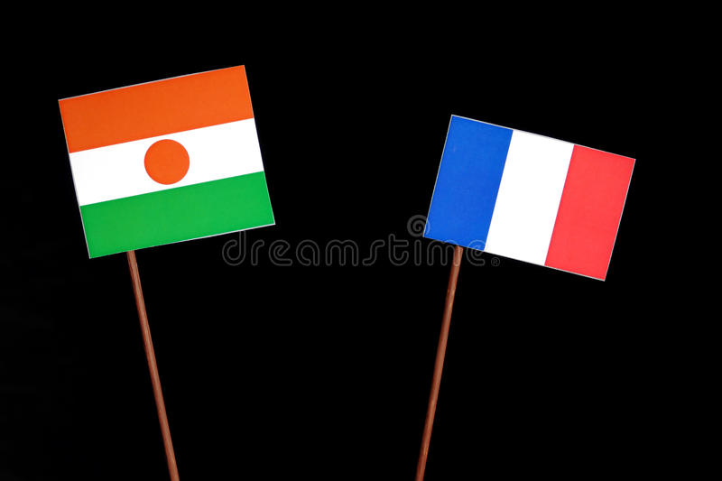 Niger flag with French flag on black. Background royalty free stock images