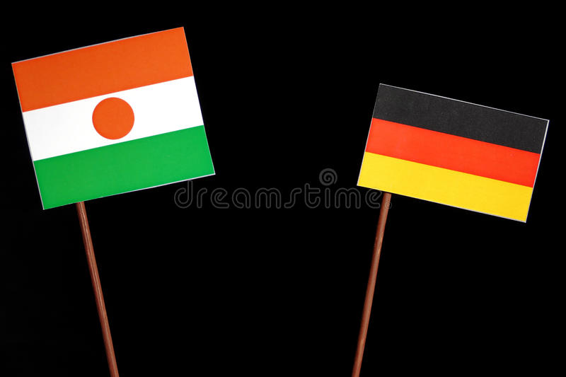 Niger flag with German flag on black. Background stock image