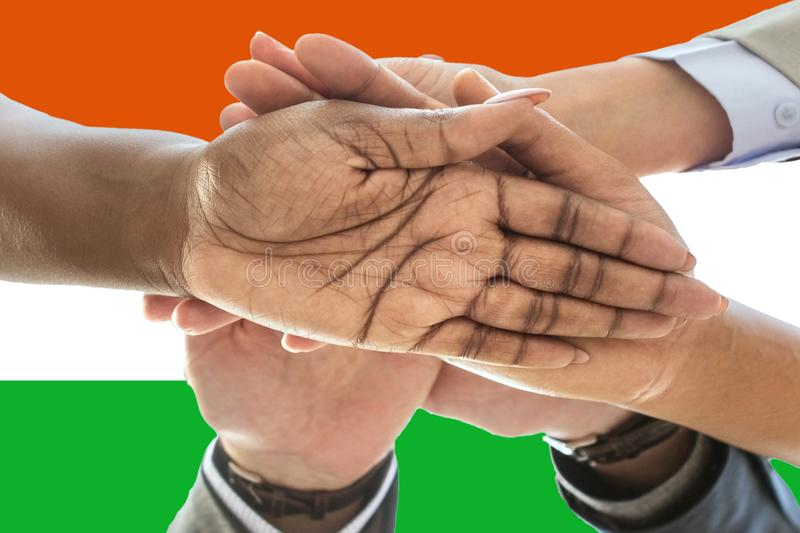 Niger flag, intergration of a multicultural group of young people.  royalty free stock images