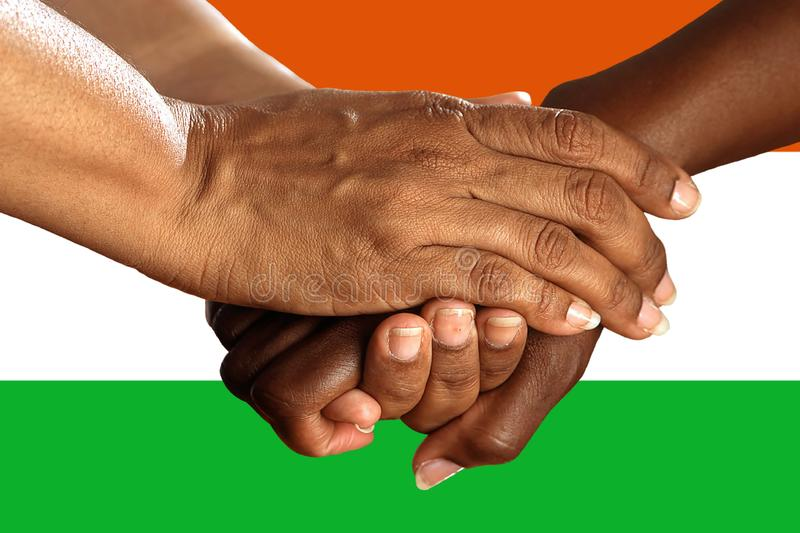 Niger flag, intergration of a multicultural group of young people.  stock photos