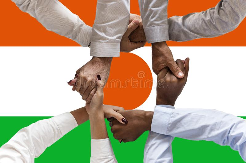 Niger flag, intergration of a multicultural group of young people.  royalty free stock photo
