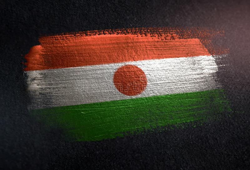 Niger Flag Made of Metallic Brush Paint on Grunge Dark Wall stock photography