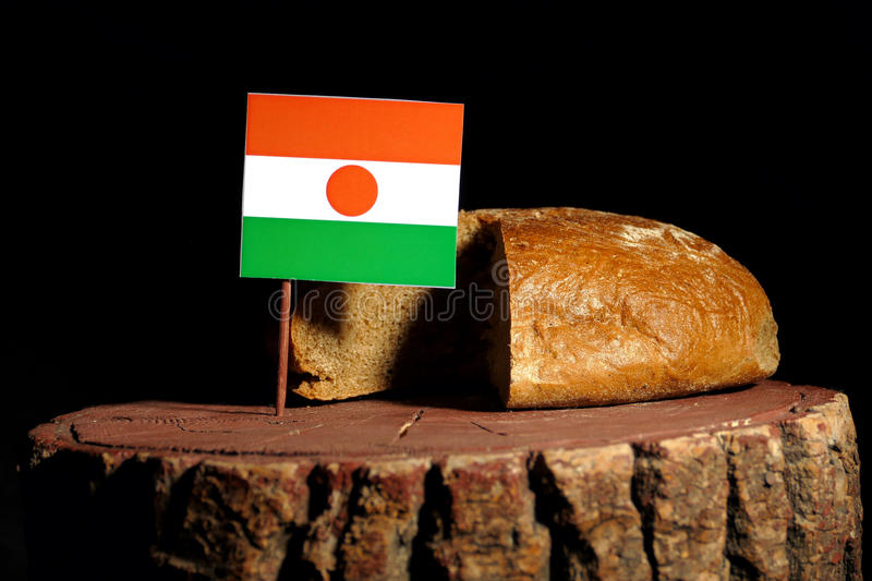 Niger flag on a stump with bread stock photography
