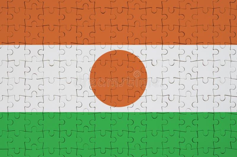 Niger flaga przedstawia na fałdowej łamigłówce fotografia stock
