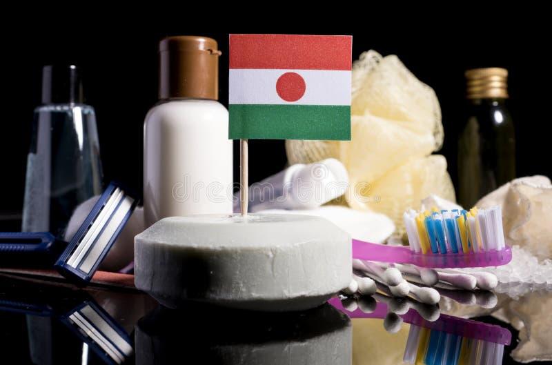 Niger flaga w mydle z wszystkie produktami dla ludzi hygi obraz royalty free