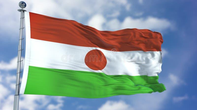 Niger flaga w niebieskim niebie obrazy royalty free