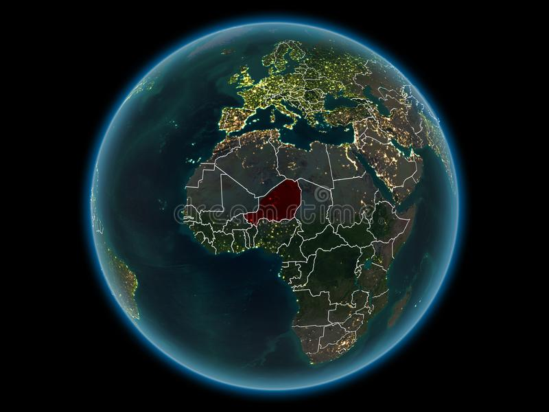 Niger on planet Earth from space at night. Niger in red with visible country borders and city lights from space at night. 3D illustration. Elements of this image royalty free stock photo