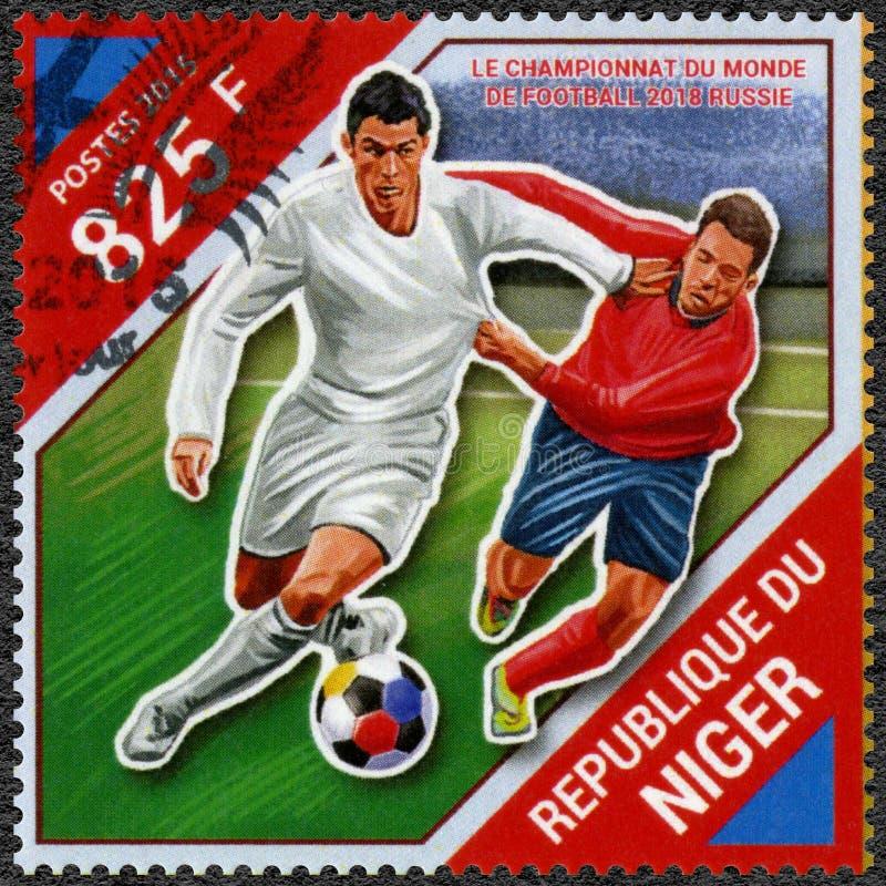 NIGER - 2015: visar fotbollsspelaren, fotbollvärldscupen 2018 Ryssland royaltyfri bild