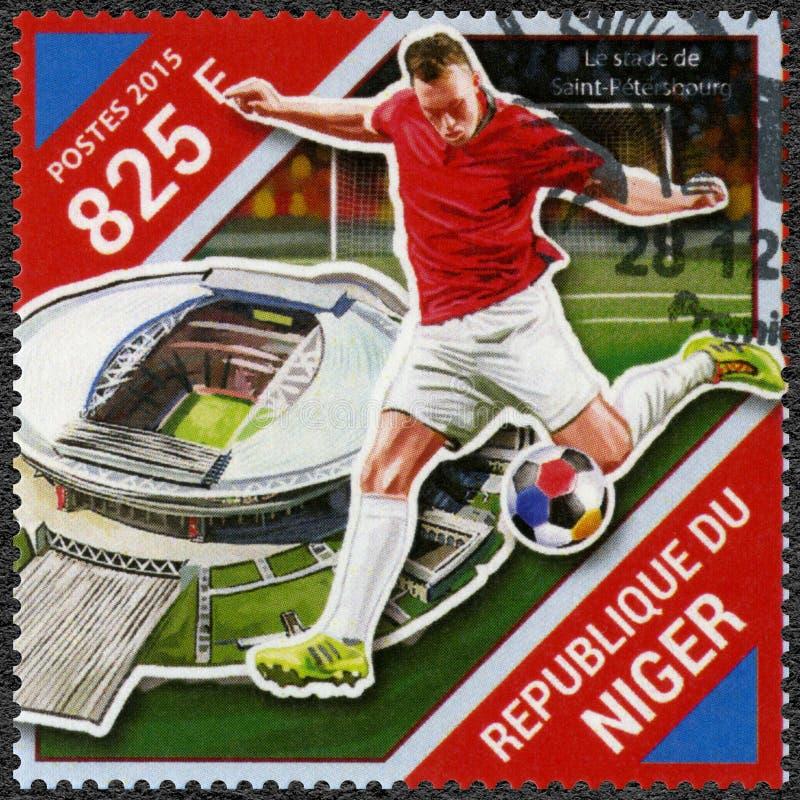 NIGER - 2015: visar fotbollsspelaren och stadion, fotbollvärldscupen 2018 Ryssland arkivbilder
