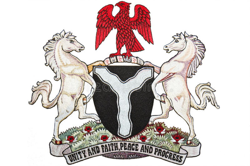 Nigeria Coat of Arms. Embroidery of Nigeria Coat of Arms on Fabric royalty free stock photography