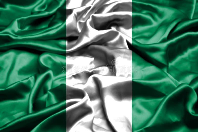 Nigeria fahnenschwenkend im Wind lizenzfreies stockbild