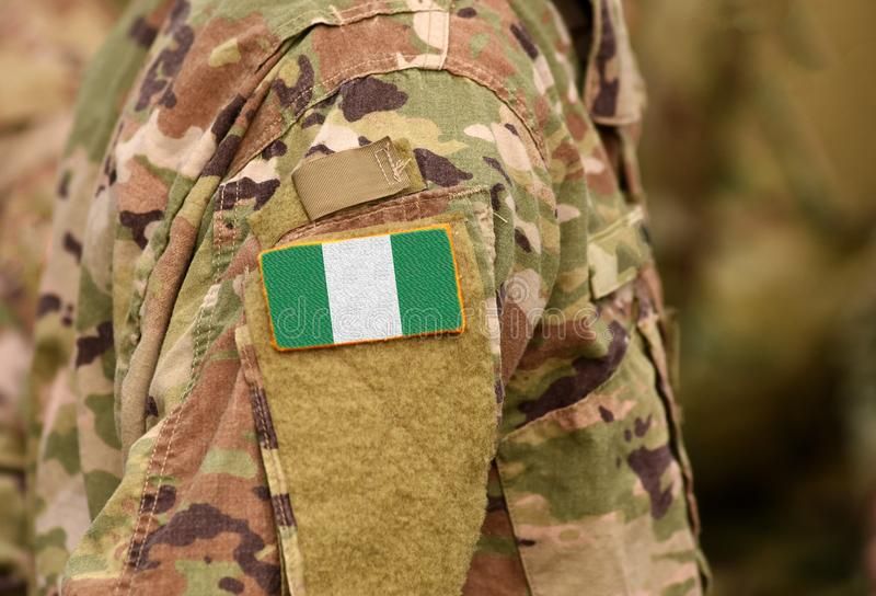Nigeria flag on soldiers arm. Federal Republic of Nigeria troops. Collage stock photography