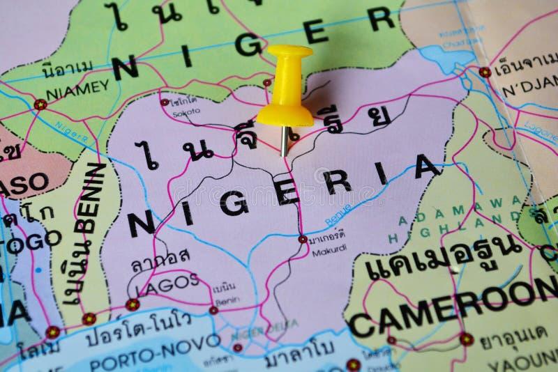 Nigeria map. Macro shot of nigeria map with push pin royalty free stock photo