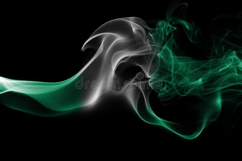 Nigeria smoke flag. Isolated on a black background stock images