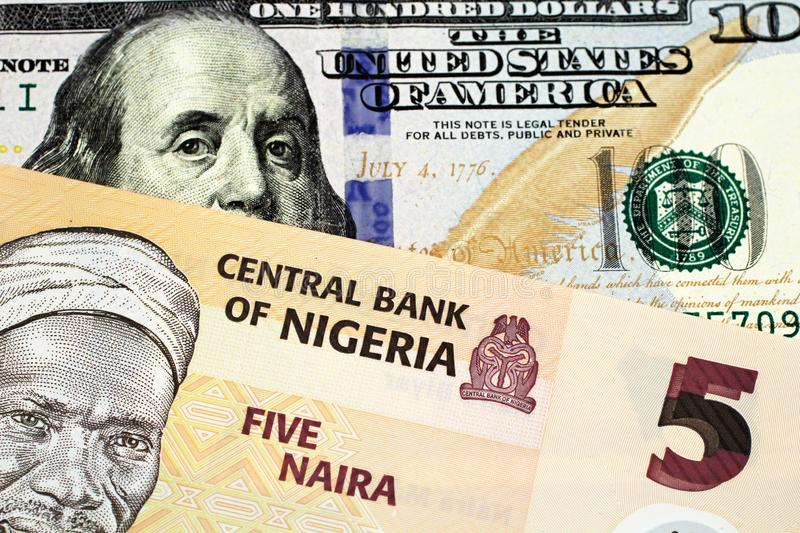A Nigerian Five Naira Note With An American One Hundred Dollar Bill stock image