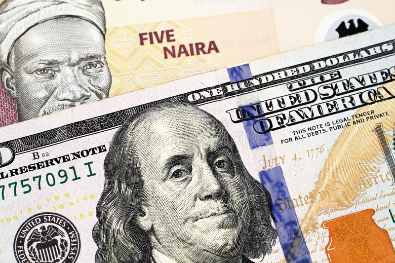 A Nigerian Five Naira Note With An American One Hundred Dollar Bill stock photos
